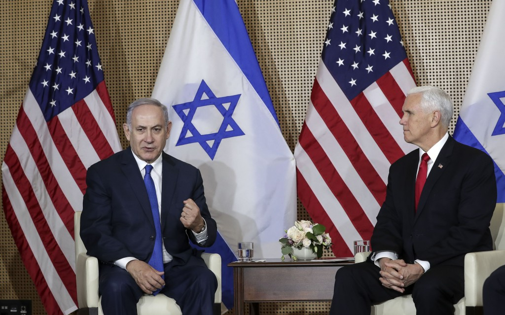 United States Vice President Mike Pence, right, watches Israeli Prime Minister Benjamin Netanyahu, left, making a fist during a bilateral meeting in W...