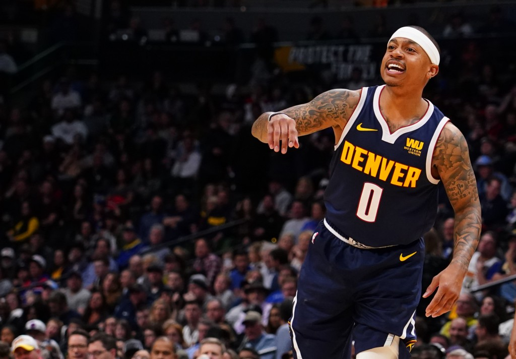 Denver Nuggets guard Isaiah Thomas motions ta a teammate during the first half of an NBA basketball game against the Sacramento Kings Thursday, Feb. 1