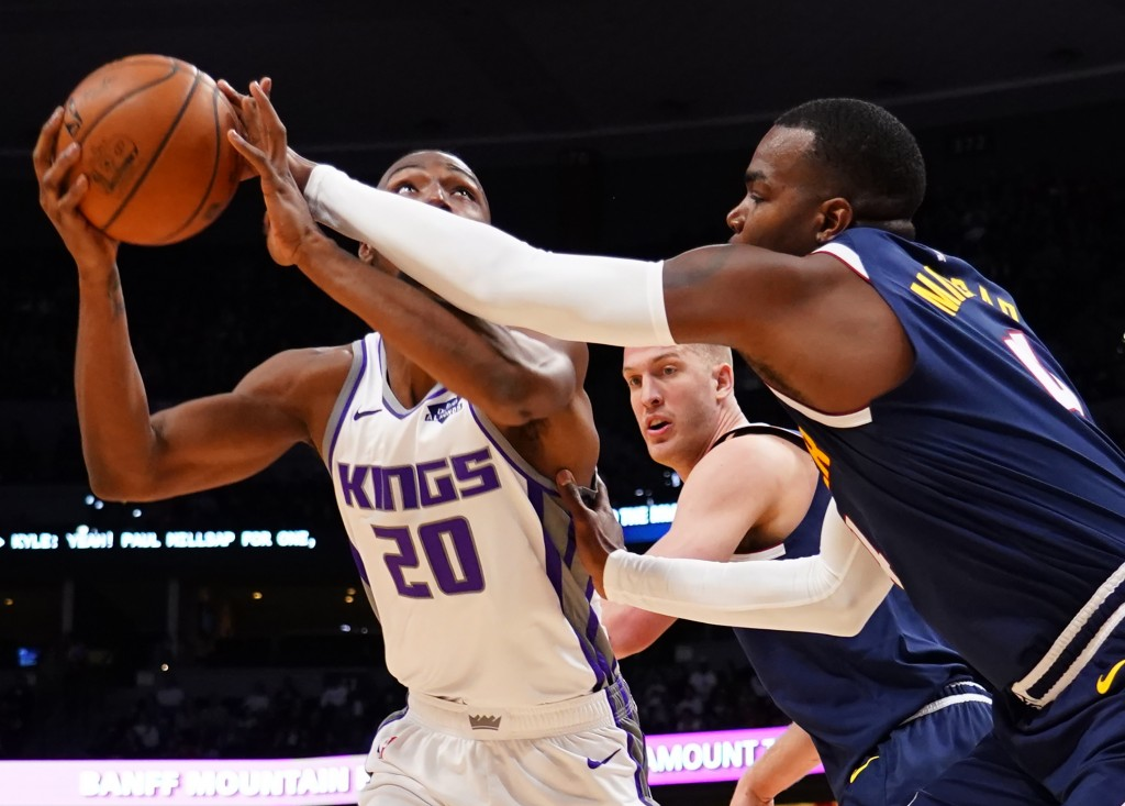 Denver Nuggets forward Paul Millsap (4) knocks the ball loose from the hands of Sacramento Kings forward Harry Giles III (20) as Denver Nuggets forwar