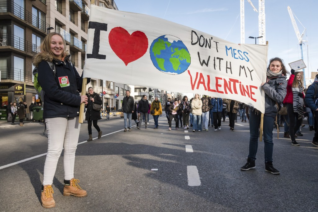 Students pose with a banner during a climate change protest in Brussels, Thursday, Feb. 14, 2019. Thousands of teenagers in Belgium have skipped schoo