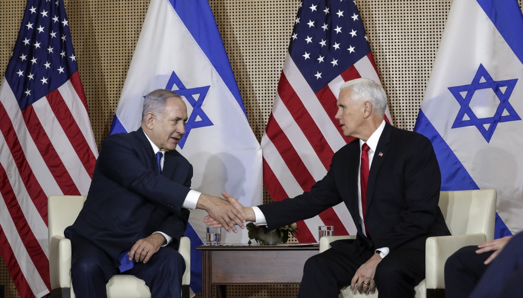 United States Vice President Mike Pence, right, shakes hands with Israeli Prime Minister Benjamin Netanyahu at a bilateral meeting in Warsaw, Poland, ...