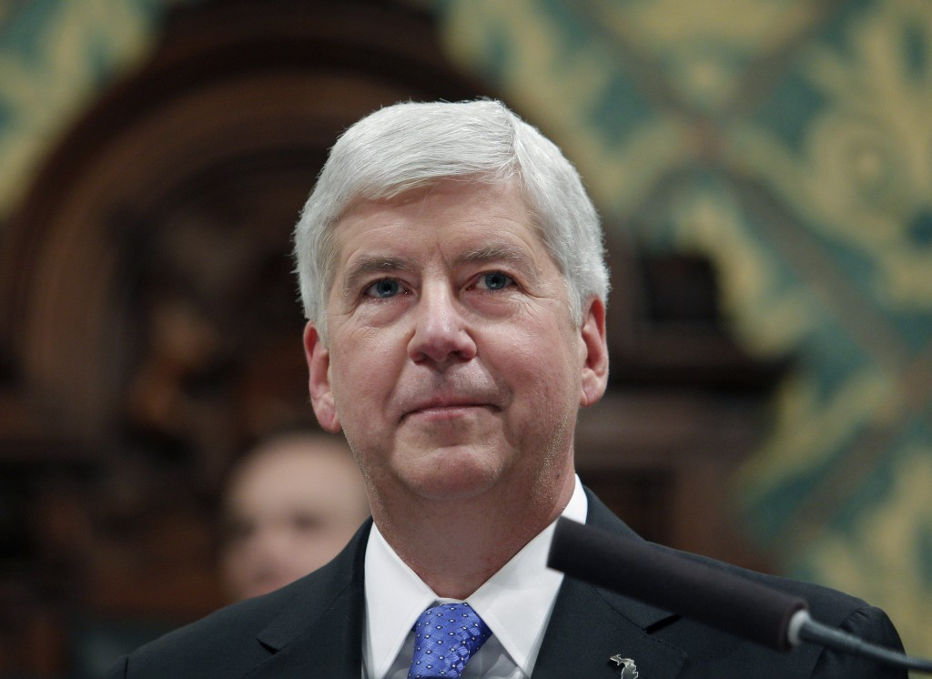 In this Jan. 23, 2018, former Michigan Gov. Rick Snyder delivers his State of the State address at the state Capitol in Lansing, Mich. In his final da...