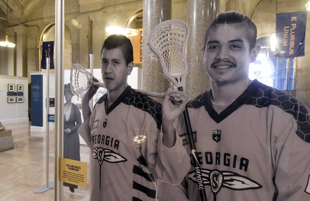 """This Monday, Feb. 11, 2019 photo shows a photograph of Onondaga Nation college lacrosse players Lyle and Miles Thompson which appears in the """"People o..."""