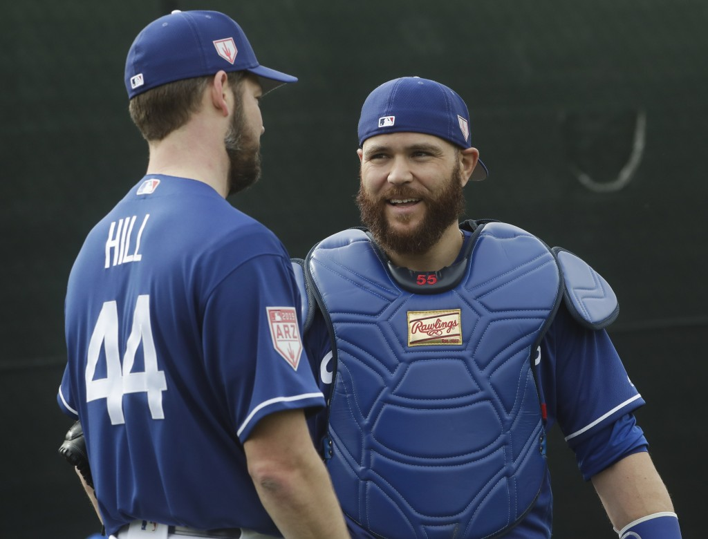 Los Angeles Dodgers catcher Russell Martin talks to pitcher Rich Hill during a spring training baseball workout Wednesday, Feb. 13, 2019, in Glendale,