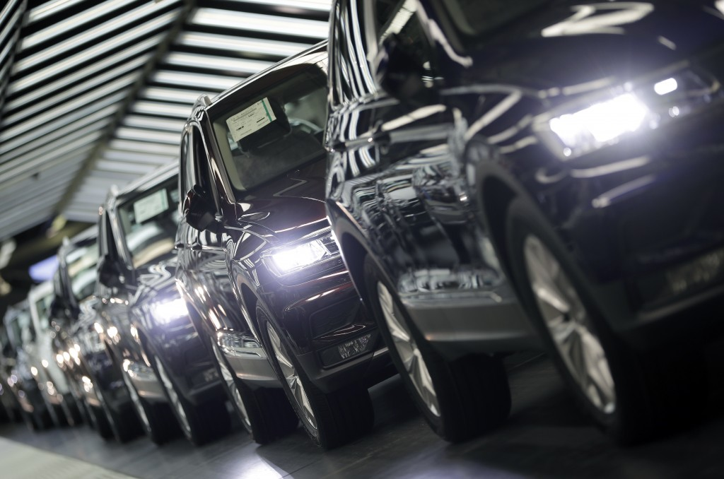 FILE - In this March 8, 2018 file photo photo Volkswagen cars are pictured during a final quality control at the Volkswagen plant in Wolfsburg, German...