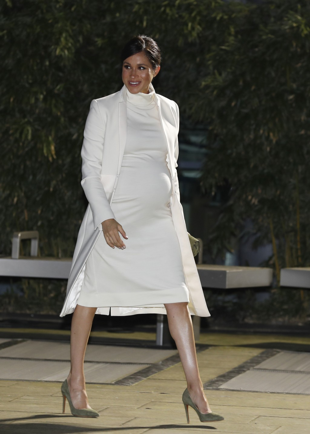 FILE - In this Tuesday, Feb. 12, 2019 file photo, Meghan, Duchess of Sussex arrives for a charity event at the Natural History museum in London. Nine ...