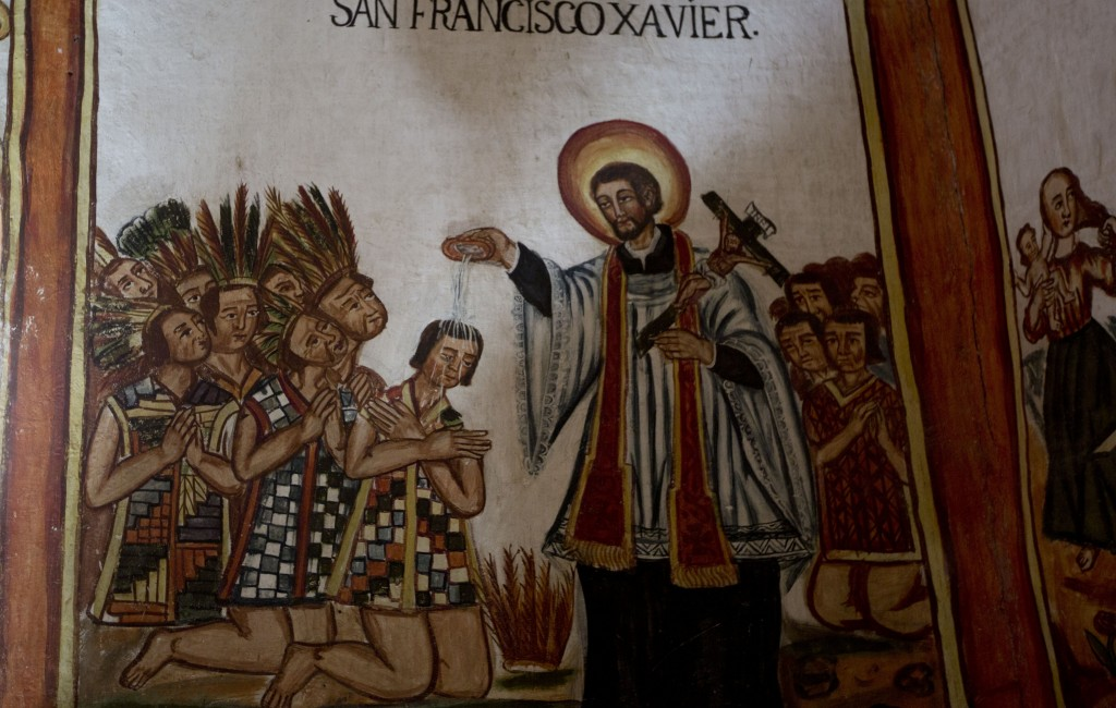"""In this Feb. 9, 2019 photo, the mural """"San Francisco Xavier baptizing the indigenous leaders"""" is displayed at the local church in Curahuara de Caranga..."""