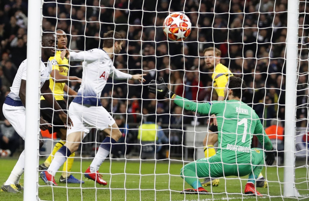 Tottenham forward Fernando Llorente, background center, celebrates after scoring his side's third goal during the Champions League round of 16, first ...