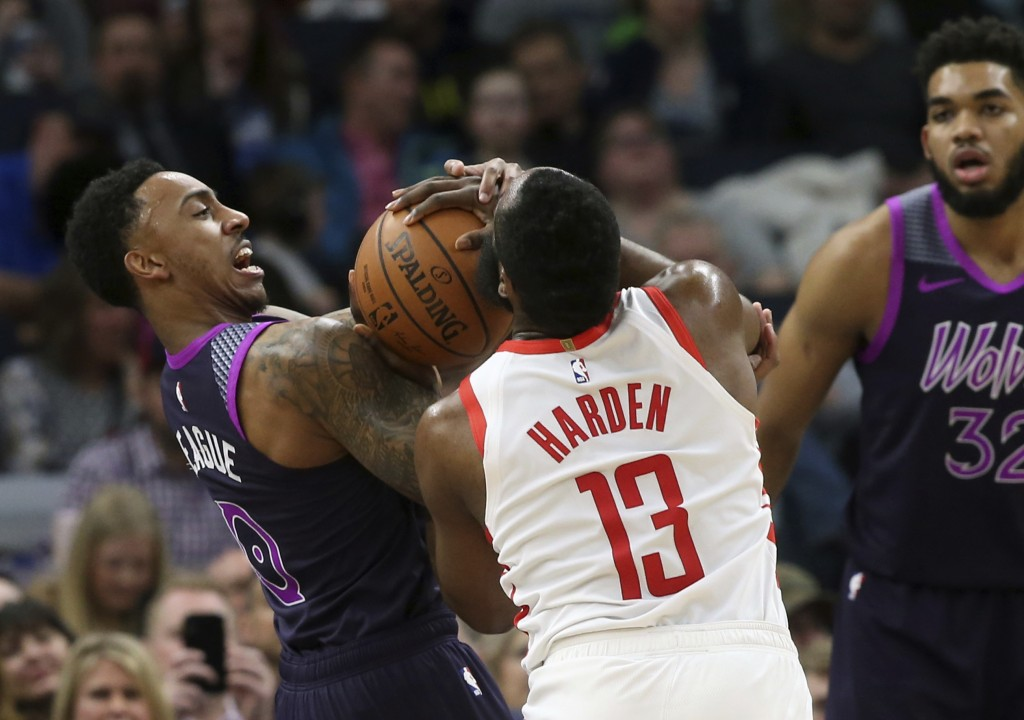 Houston Rockets' James Harden (13) and Minnesota Timberwolves' Jeff Teague battle for the ball as Timberwolves' Karl-Anthony Towns (32) looks on in th