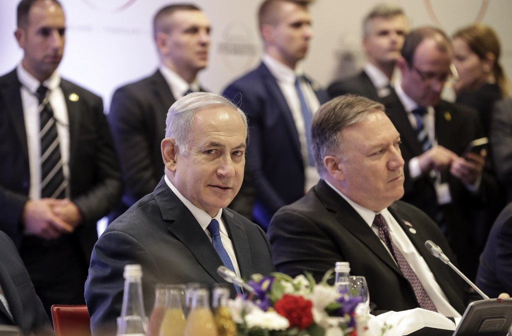 Israeli Prime Minister Benjamin Netanyahu, left, sits beside United State Secretary of State Mike Pompeo, right, at a conference on Peace and Security...