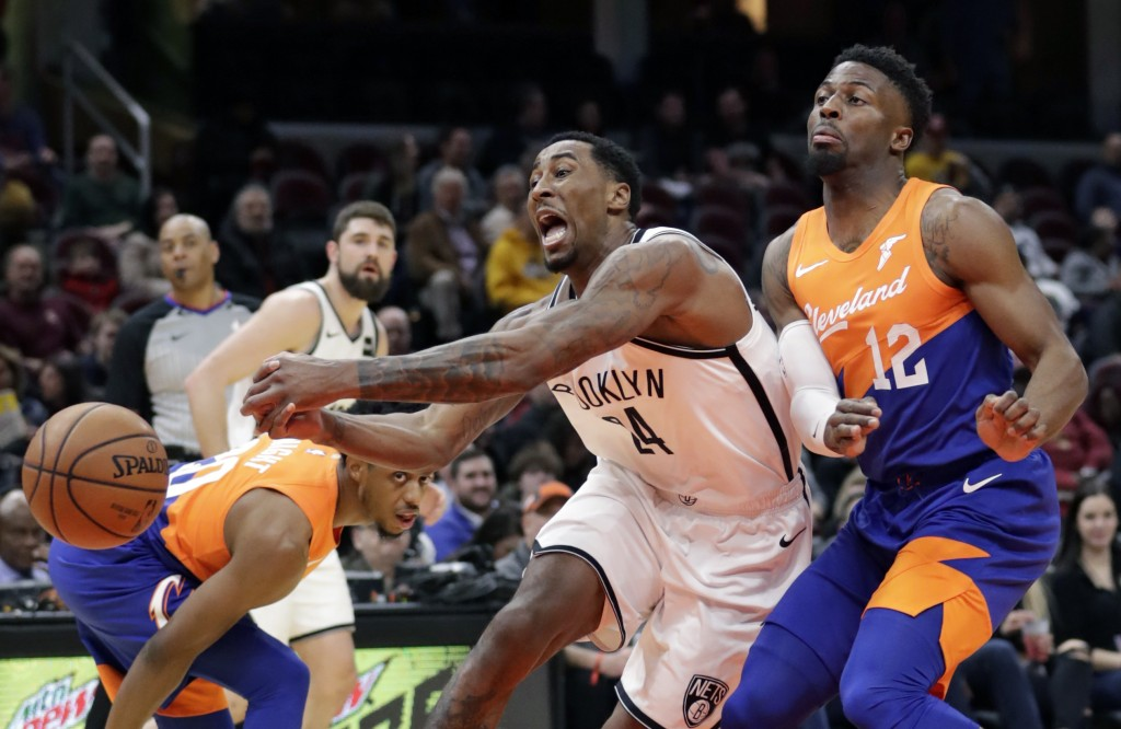 Brooklyn Nets' Rondae Hollis-Jefferson (24) loses control of the ball against Cleveland Cavaliers' David Nwaba (12) in the first half of an NBA basket