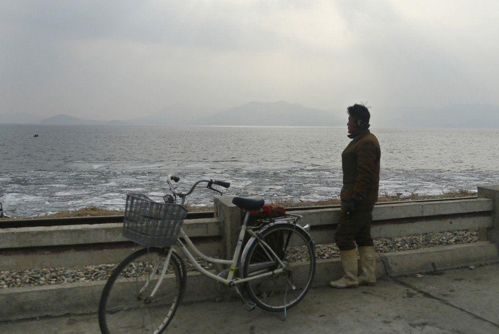 In this Feb. 2, 2019, photo, a North Korean man looks out to the sea as he stands on the West Sea Barrage in Nampo, North Korea. North Korea is explor