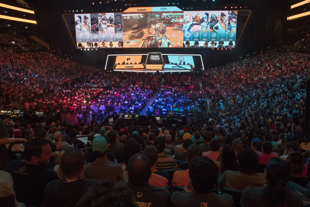 FILE - In this July 28, 2018, file photo, fans watch the competition between Philadelphia Fusion and London Spitfire during the Overwatch League Grand