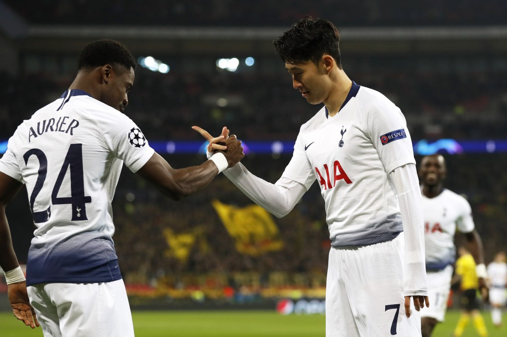 Tottenham midfielder Son Heung-min celebrates with defender Serge Aurier, left, after scoring the opening goal during the Champions League round of 16...