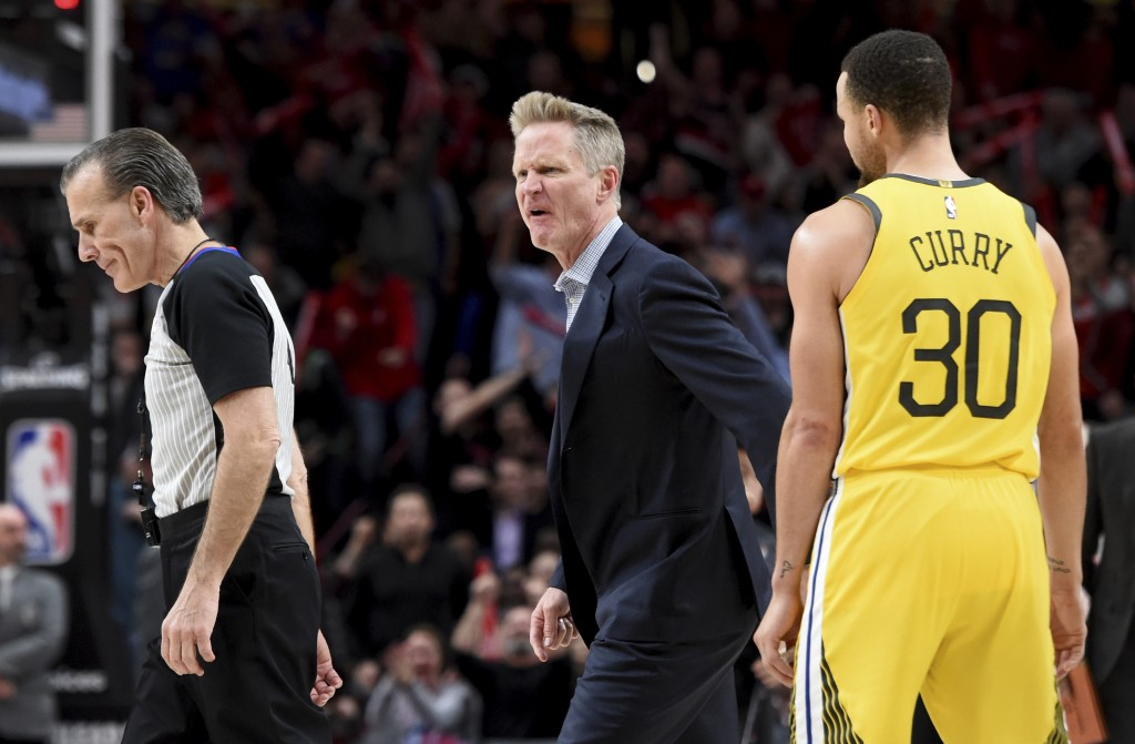 Golden State Warriors coach Steve Kerr, center, yells at referee Ken Mauer, left, after being called for a technical foul, while guard Stephen Curry, ...