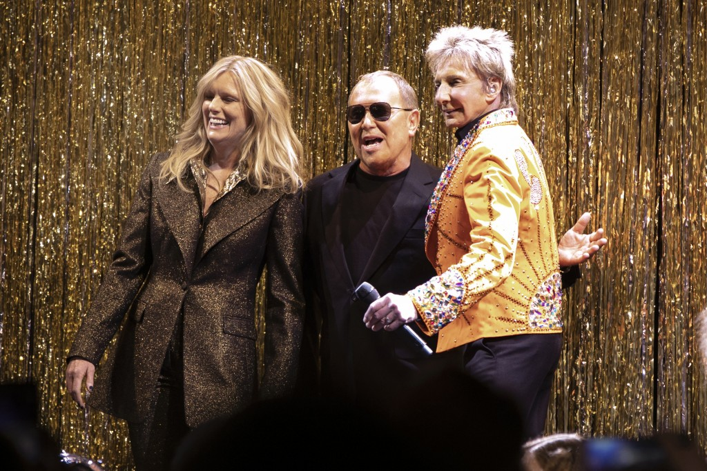 Designer Michael Kors, center, is joined by model Patti Hansen and Barry Manilow on stage after his collection was modeled during Fashion Week in New