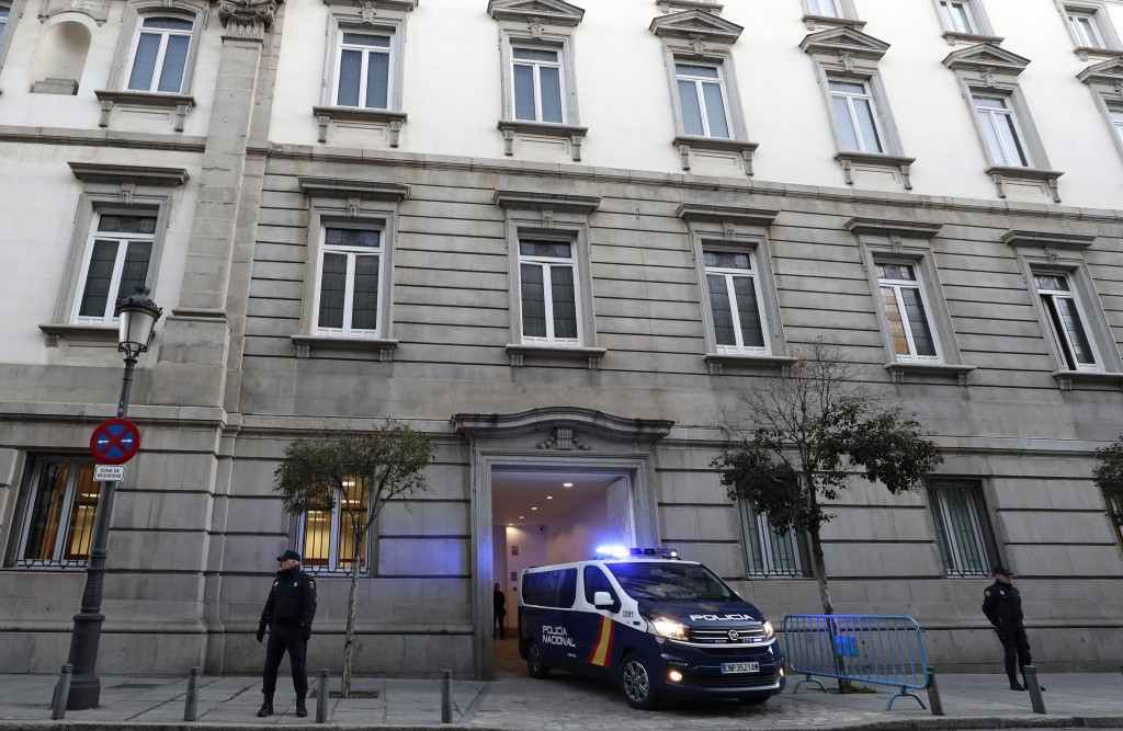 A Spanish National Police van, allegedly carrying Catalonian politicians and activists, arrives at the Spanish Supreme Court in Madrid, Thursday, Feb....