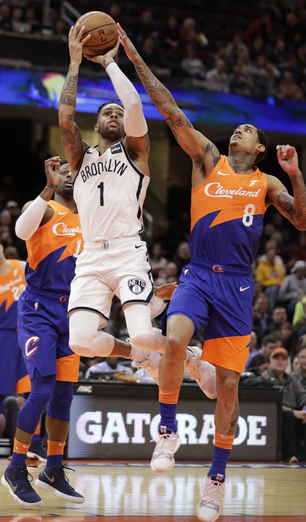 Brooklyn Nets' D'Angelo Russell (1) drives to the basket against Cleveland Cavaliers' Jordan Clarkson (8) in the first half of an NBA basketball game,