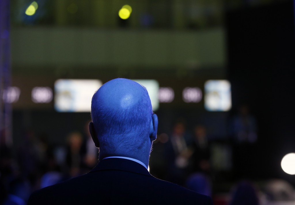 A man is caught in the light show as he watches the ceremony as France's Vinci Airports takes over the running of Belgrade Nikola Tesla Airport in Bel...