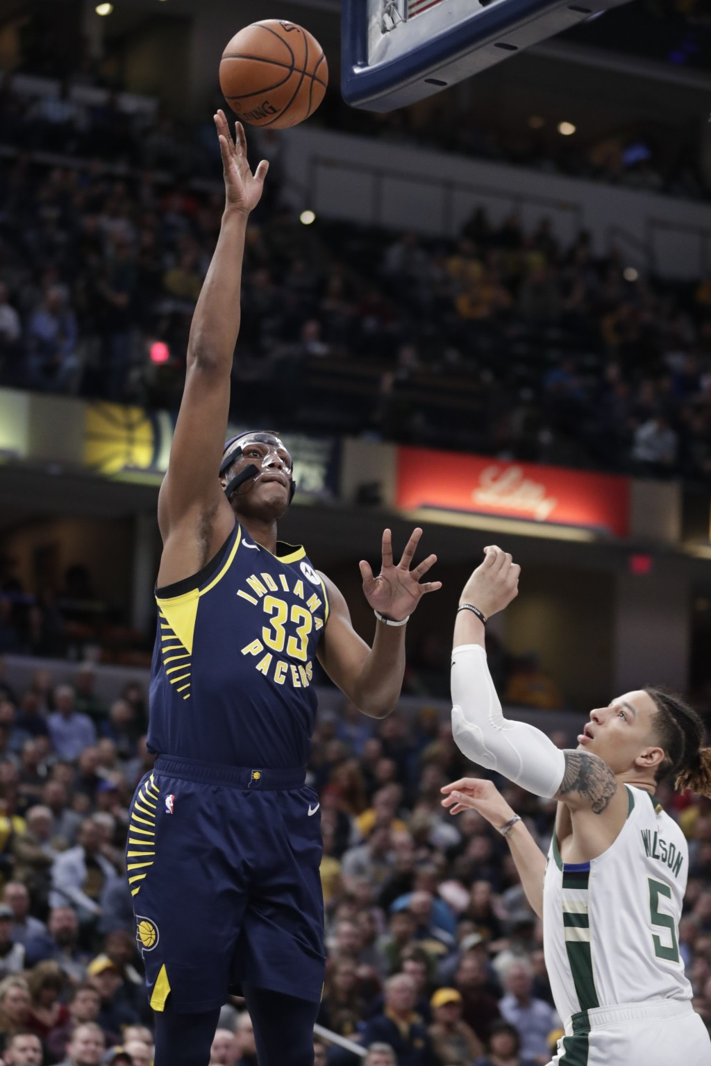 Indiana Pacers center Myles Turner (33) shoots over Milwaukee Bucks forward D.J. Wilson (5) during the first half of an NBA basketball game in Indiana