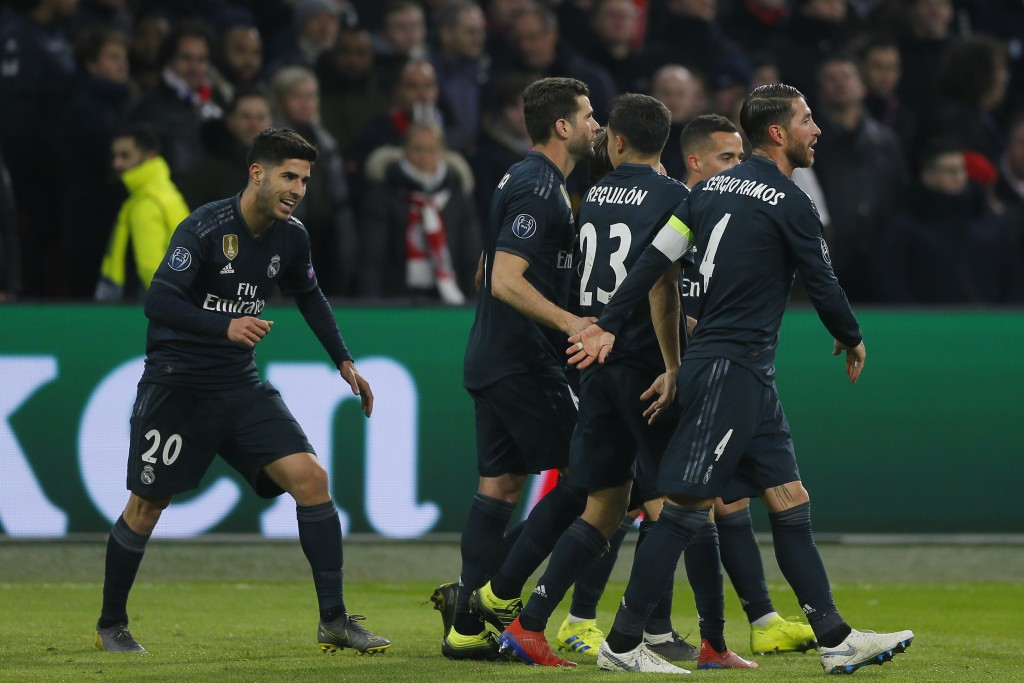 Real midfielder Marco Asensio, left, celebrates after scoring his side's second goal during the first leg, round of sixteen, Champions League soccer m...