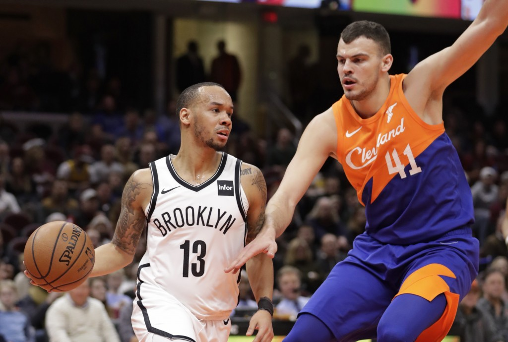 Brooklyn Nets' Shabazz Napier (13) drives past Cleveland Cavaliers' Ante Zizic (41), from Croatia, in the first half of an NBA basketball game, Wednes