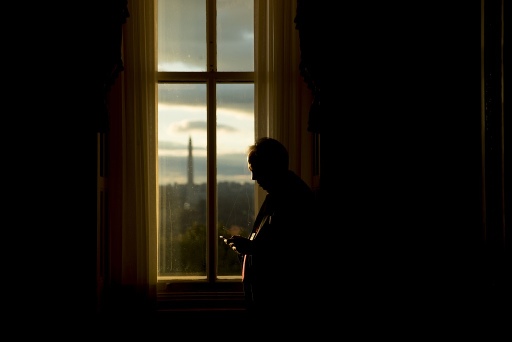 FILE- In this Jan. 24, 2019, file photo the Washington Monument is visible through a window of the U.S. Capitol building at sunset on Capitol Hill in