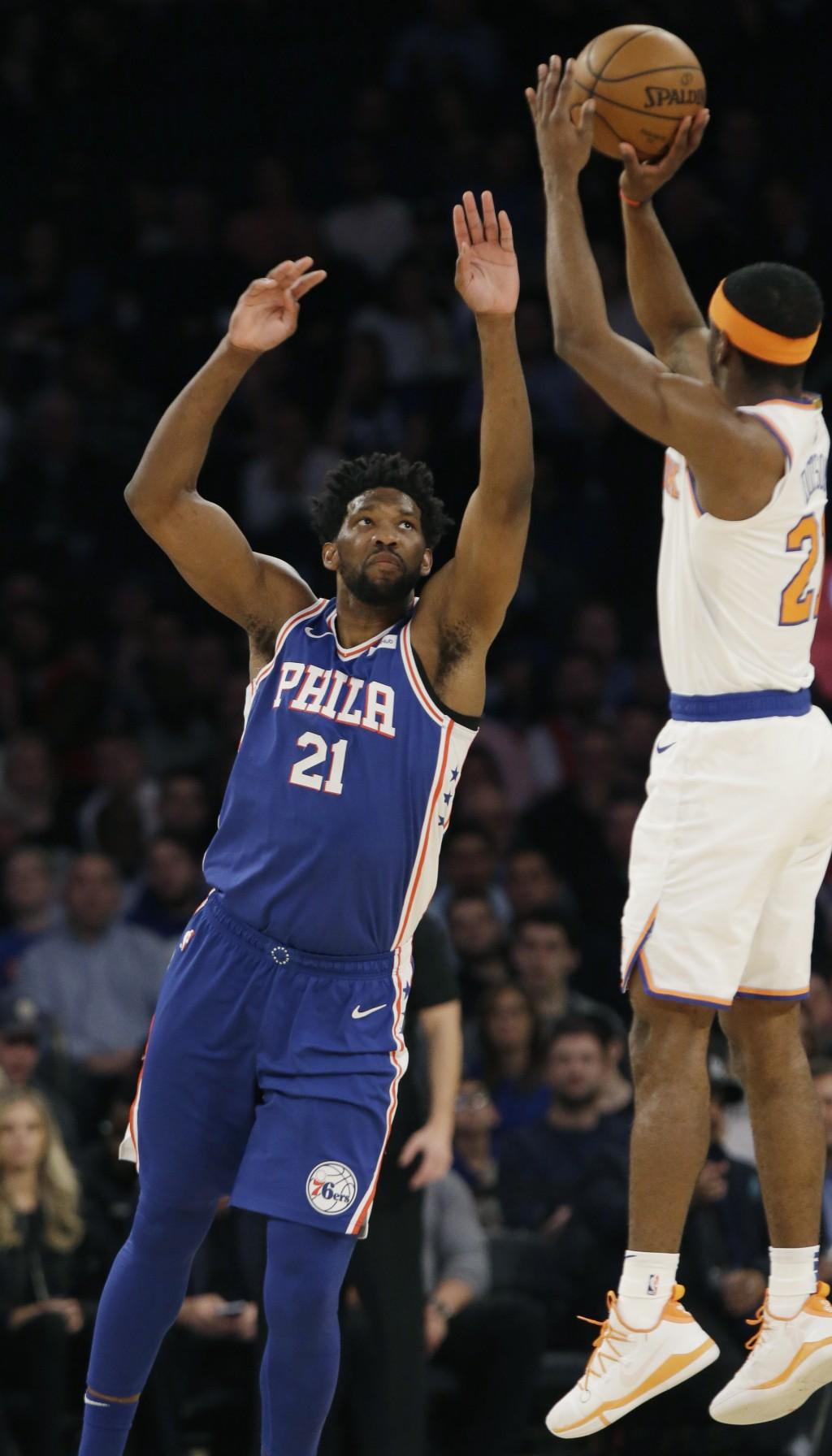 Philadelphia 76ers' Joel Embiid (21) runs out to defend a shot by New York Knicks' Damyean Dotson (21) during the first half of an NBA basketball game