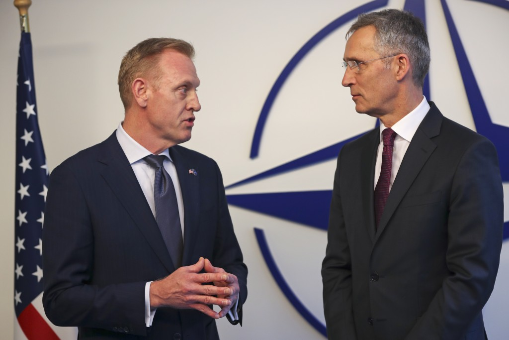 Acting US Defence Secretary Patrick Shanahan, left, talks to NATO's Secretary General Jens Stoltenberg for the media during a meeting of NATO defence ...