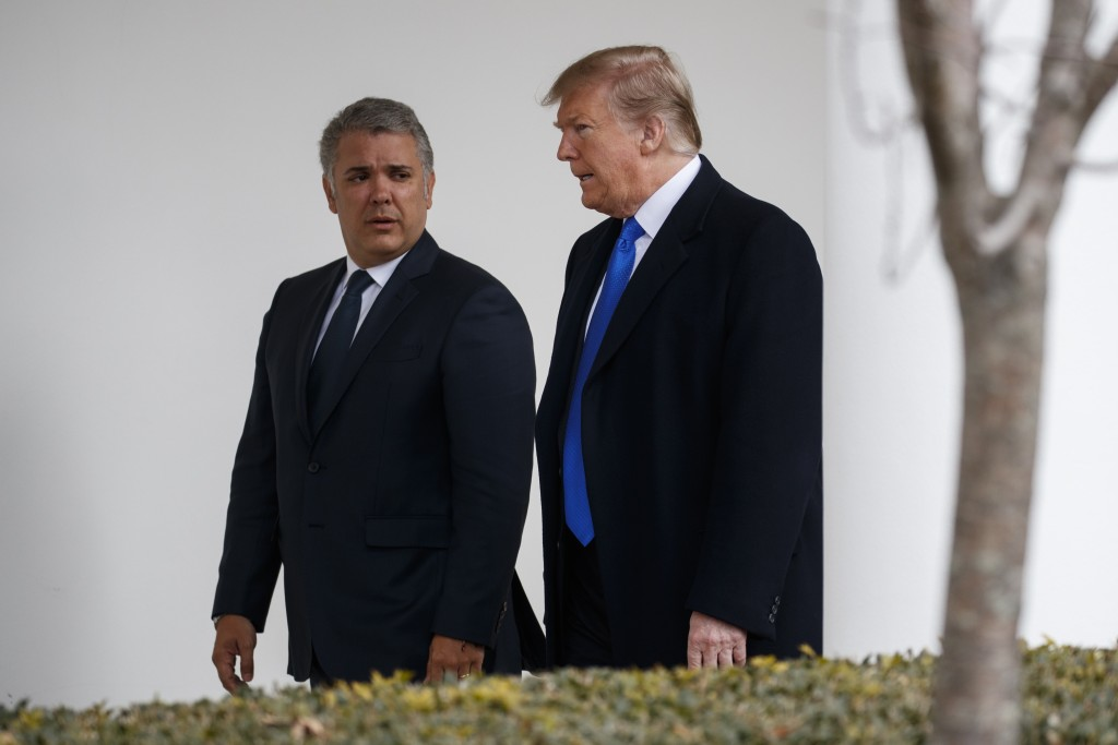 President Donald Trump walks with Colombian President Ivan Duque to a meeting in the Oval Office of the White House, Wednesday, Feb. 13, 2019, in Wash...