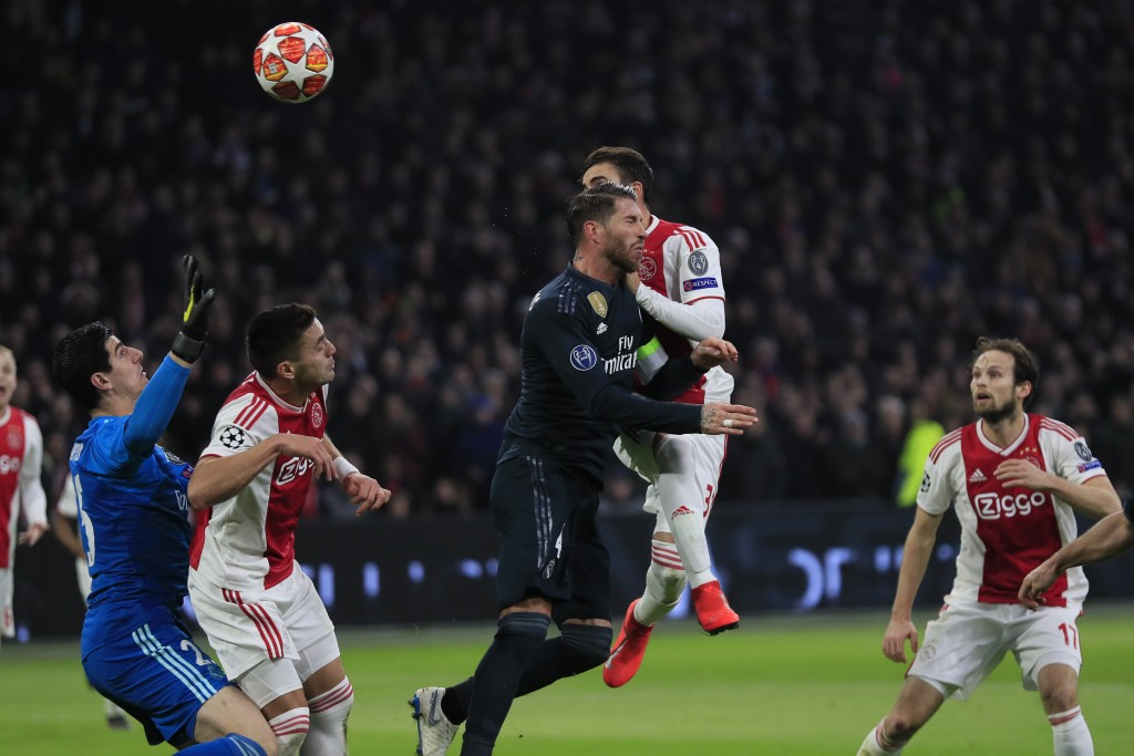 Ajax's Nicolas Tagliafico, second right, heads the ball past Real defender Sergio Ramos to scores his side's opening goal and the goal was disallowed ...
