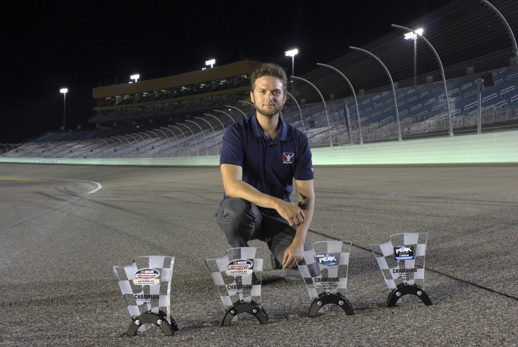 This Nov. 18, 2018, photo provided by Bryan Blackford and Snowcone Productions shows Ray Alfalla with his awards on the track at Homestead-Miami Speed