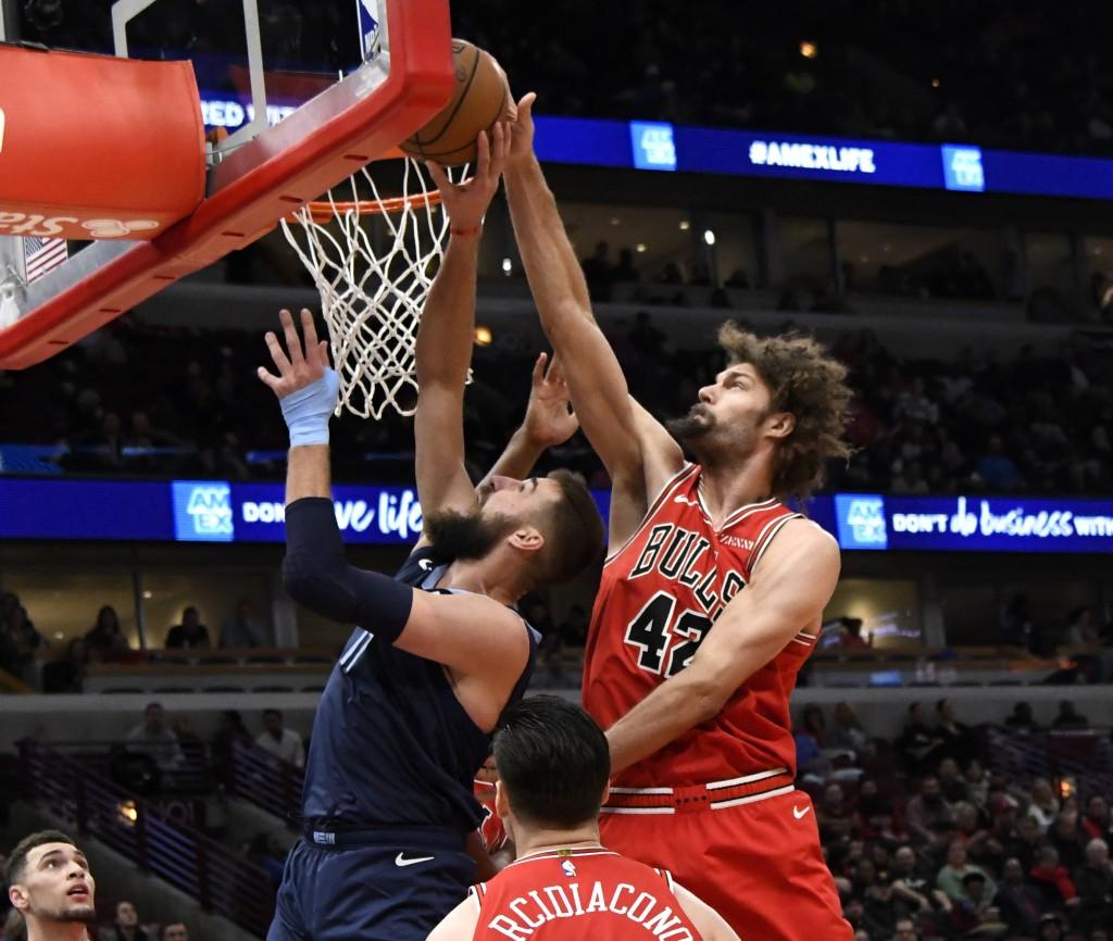 Chicago Bulls center Robin Lopez (42) blocks the shot of Memphis Grizzlies center Jonas Valanciunas (17) during the first half of an NBA basketball ga...