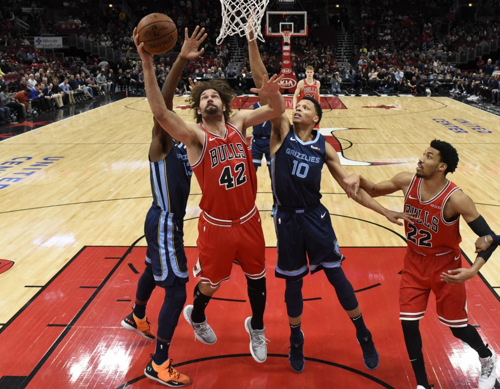 Chicago Bulls center Robin Lopez (42) goes to the basket as Memphis Grizzlies forward Ivan Rabb (10) defends during the first half of an NBA basketbal...