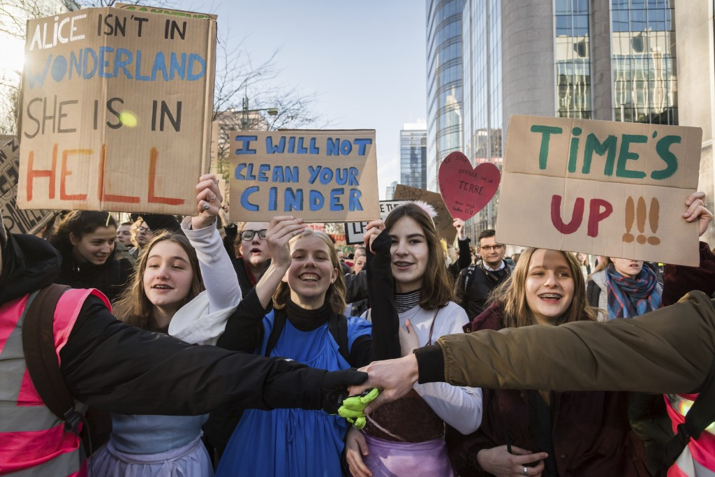Students march during a climate change protest in Brussels, Thursday, Feb. 14, 2019. Thousands of teenagers in Belgium have skipped school for the six