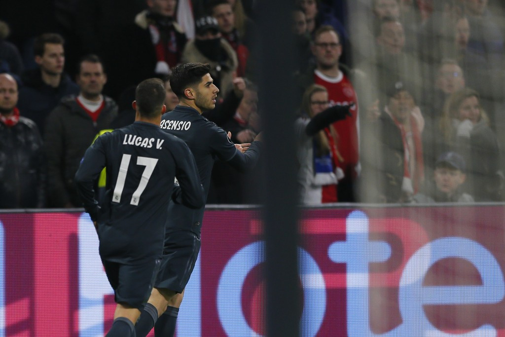 Real midfielder Marco Asensio, right, celebrates after scoring his side's second goal during the first leg, round of sixteen, Champions League soccer ...