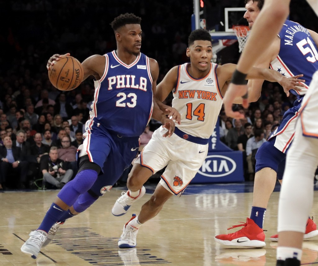 Philadelphia 76ers' Jimmy Butler (23) drives past New York Knicks' Allonzo Trier (14) during the first half of an NBA basketball game, Wednesday, Feb....