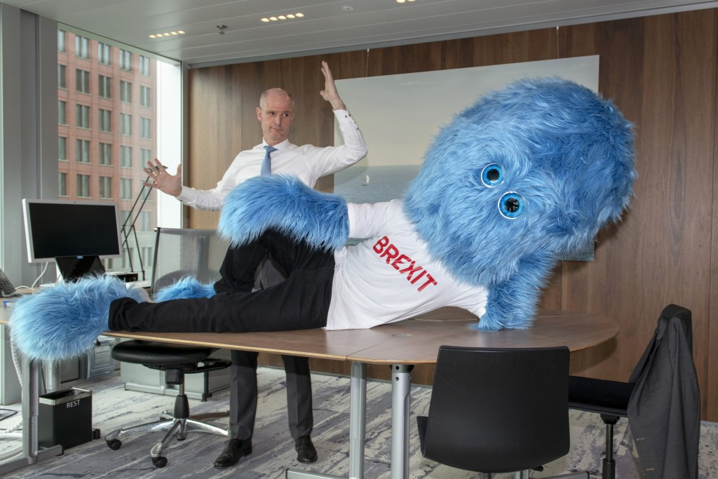 This image made available by the Netherlands Foreign Ministry on Thursday Feb. 14, 2019, shows Foreign Minister Stef Blok and a hairy blue Brexit mons...