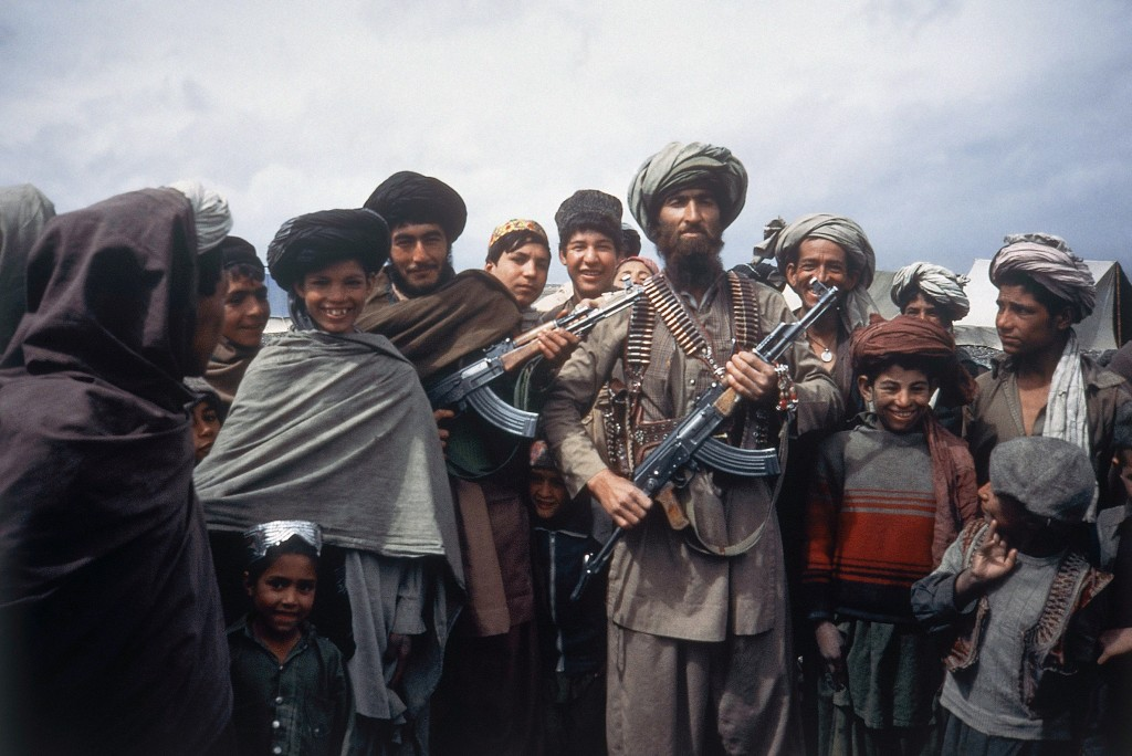 FILE - This file photo taken on April 1, 1984 shows mujahedeen tribesmen at border camp near Wana in Afghanistan. As Russia prepares to mark the Feb.