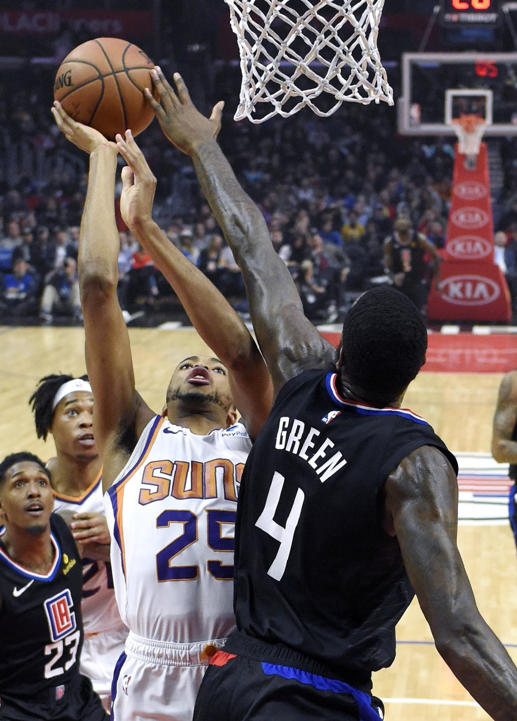 Phoenix Suns forward Mikal Bridges shoots as Los Angeles Clippers forward JaMychal Green defends during the first half of an NBA basketball game Wedne