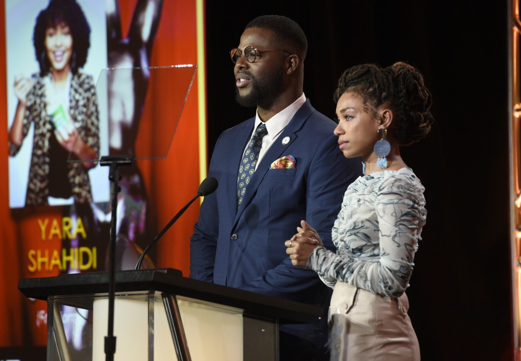 Logan Browning, right, reacts as Winston Duke announces her as a nominee for the 50th annual NAACP Image Awards during TV One's Winter Television Crit