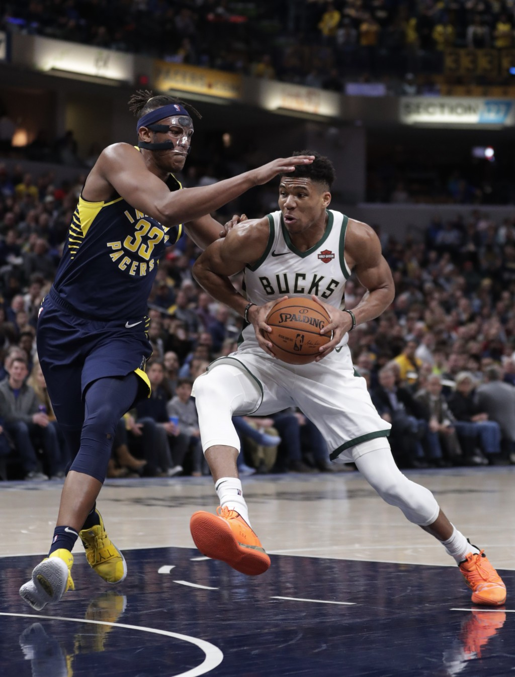 Milwaukee Bucks forward Giannis Antetokounmpo (34) drives on Indiana Pacers center Myles Turner (33) during the second half of an NBA basketball game ...