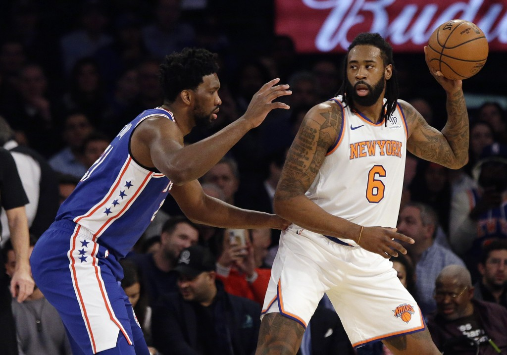 Philadelphia 76ers' Joel Embiid, left, defends New York Knicks' DeAndre Jordan during the first half of an NBA basketball game, Wednesday, Feb. 13, 20...