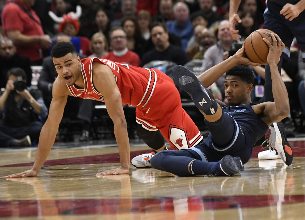 Memphis Grizzlies forward Bruno Caboclo, right, grabs a loose ball as Chicago Bulls guard Timothy Luwawu-Cabarrot, left, looks on during the first hal...