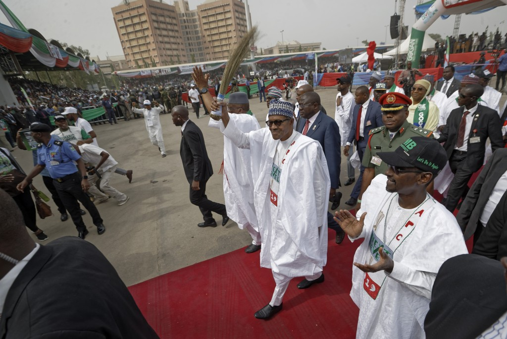 Incumbent President Muhammadu Buhari gestures to supporters at a campaign rally in Abuja, Nigeria Wednesday, Feb. 13, 2019. Nigeria is due to hold gen...