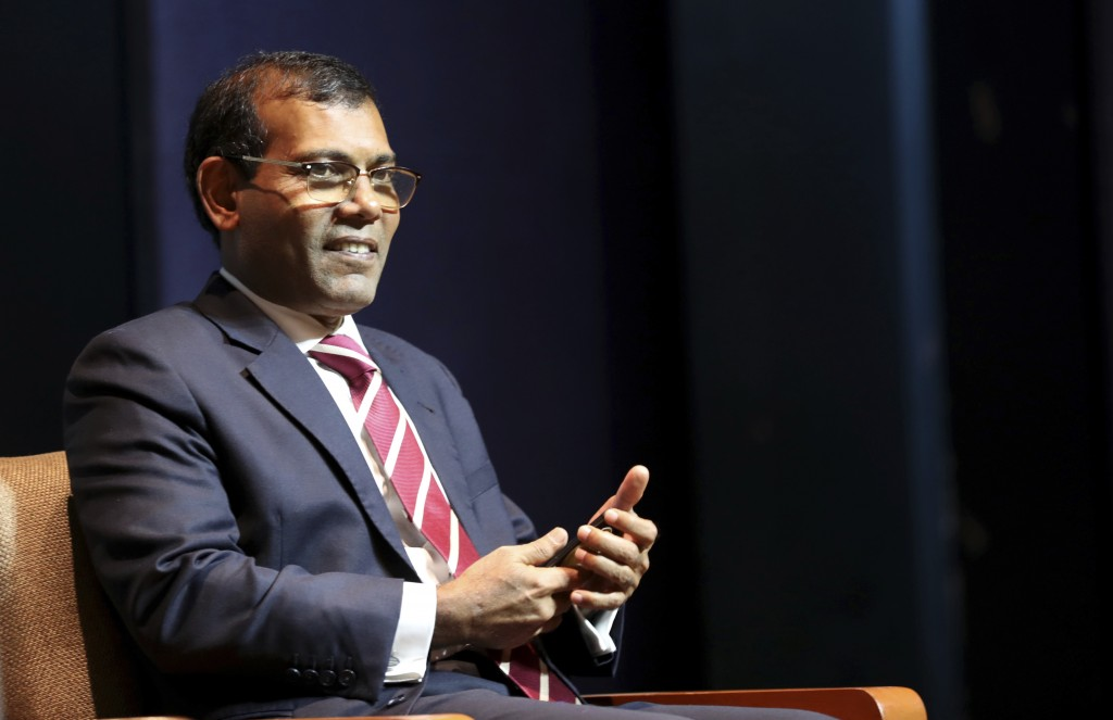 Former Maldives President Mohamed Nasheed takes a seat before delivering a lecture on climate change in New Delhi, India, Thursday, Feb. 14, 2019. In
