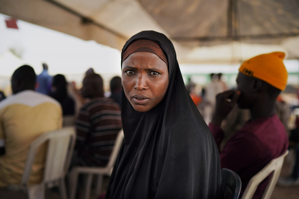 A Nigerian woman attends an inter-faith prayer rally organized by the Freedom and Justice Party in Abuja, Nigeria, Thursday Feb. 14, 2019. Incumbent P