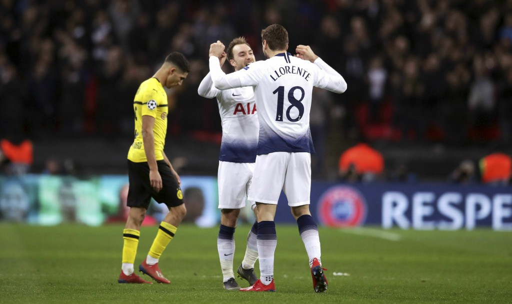 Tottenham Hotspur's Christian Eriksen, left, and Fernando Llorente embrace after the UEFA Champions League round of 16, first leg match at Wembley Sta
