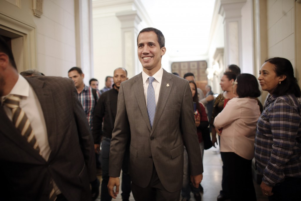 Venezuela' self proclaimed interim president Juan Guaido smiles as he arrives at the National Assembly, in Caracas, Venezuela, Wednesday, Feb. 13, 201