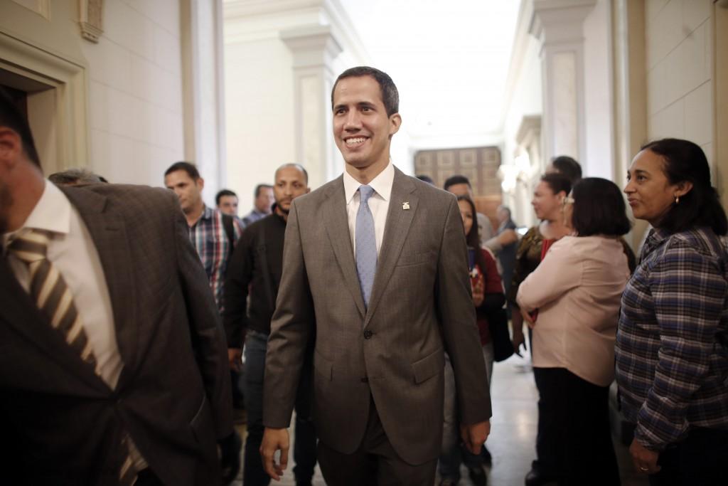 Venezuela' self proclaimed interim president Juan Guaido smiles as he arrives at the National Assembly, in Caracas, Venezuela, Wednesday, Feb. 13, 201...
